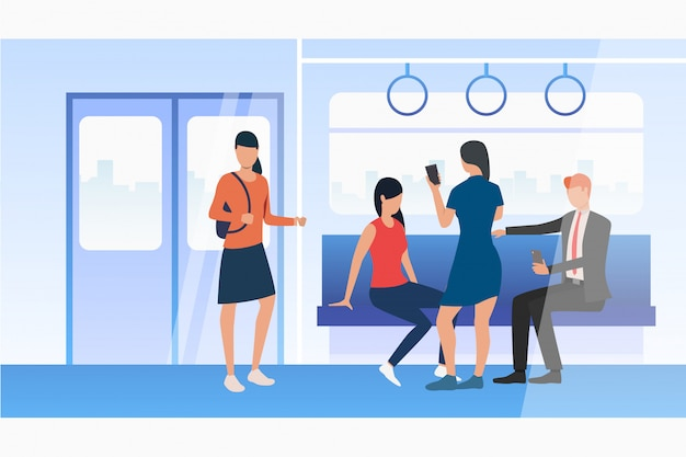 People using mobile phones in subway train Free Vector