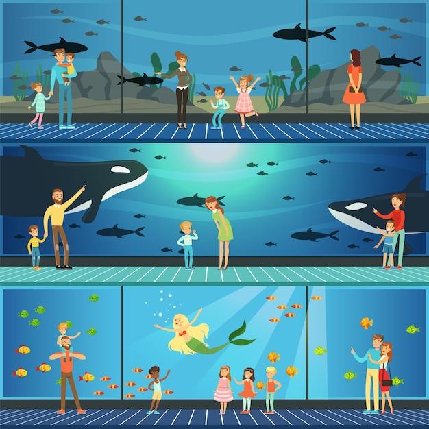 イラストの水族館セットを訪れる人々、巨大な水族館で海の動物たちと一緒に水中の風景を見ている子供を持つ親 Premiumベクター