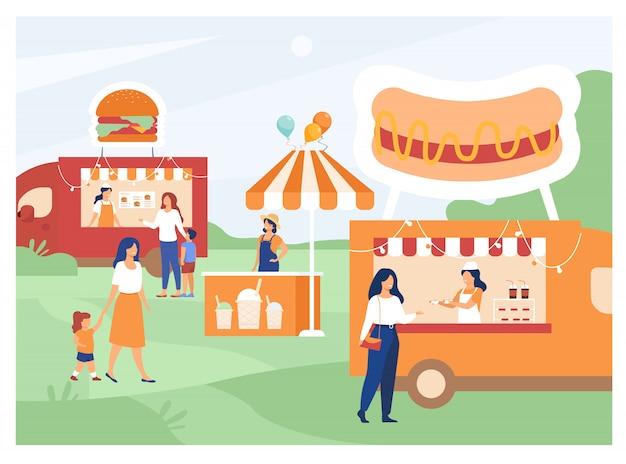 Люди посещают ярмарку уличной еды Бесплатные векторы