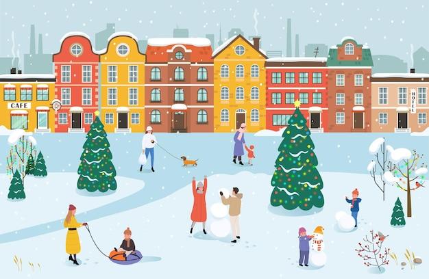 人々は冬に公園を散歩します。冬の活動をしている男性、女性、子供たち。 Premiumベクター