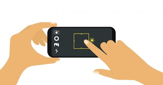 Телефон в руке. делайте снимки на телефон. Premium векторы