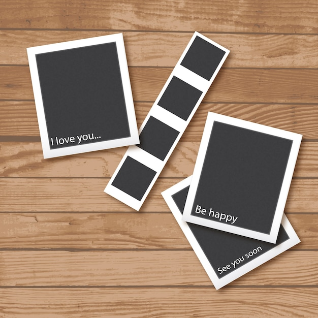 Photo frames collection on a wooden background Free Vector
