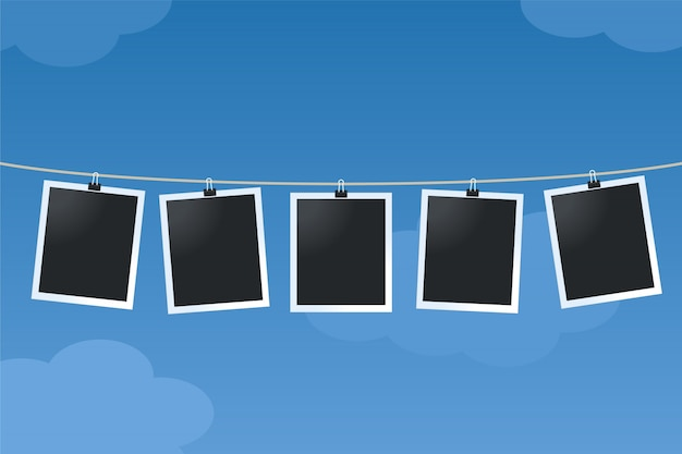 Photo frames hanging from a cord Premium Vector