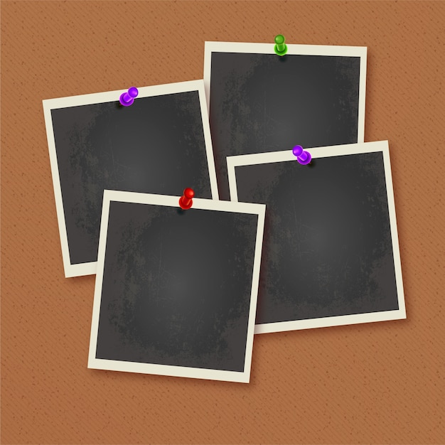 Photo frames pinned on wall Free Vector