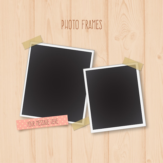 Photo frames on a wooden background Free Vector