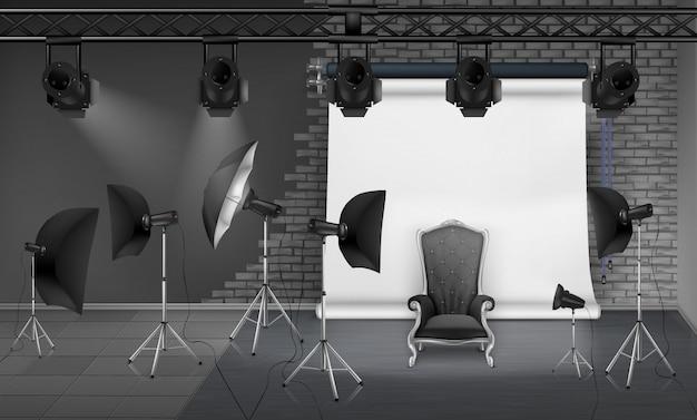 Photo studio interior with empty armchair, gray brick wall, white projector screen, spotlight Free Vector