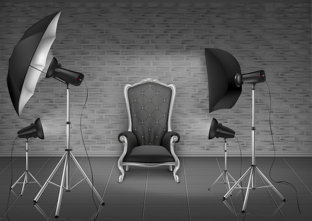 Photo studio with empty armchair and gray brick wall, lamps, umbrella diffuser Free Vector