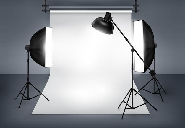 Photo studio with lighting equipment flash spotlight and softbox. Free Vector