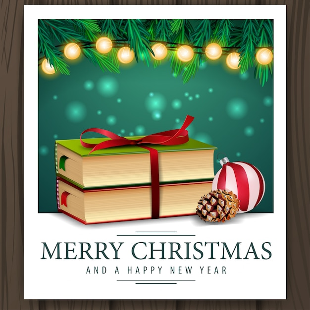 Photo with christmas books and merry christmas greetings Premium Vector