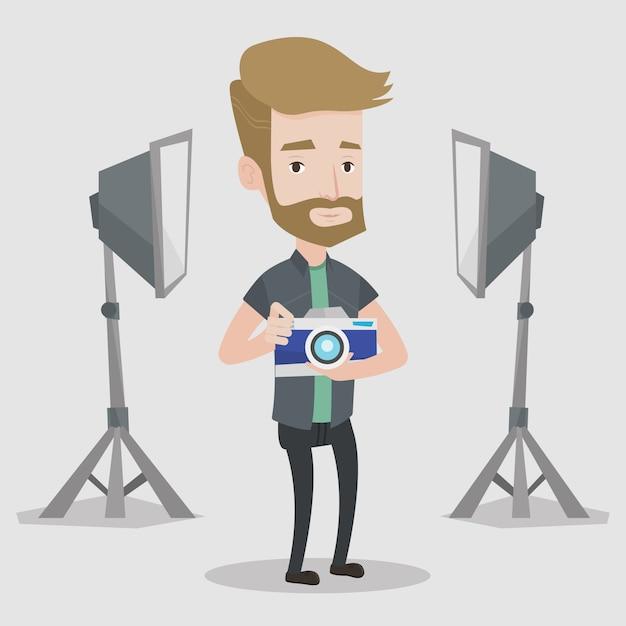 Photographer with camera in photo studio. Premium Vector
