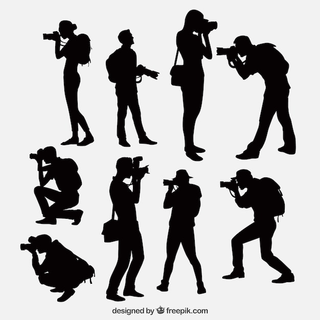 Photographers with camera silhouettes Free Vector