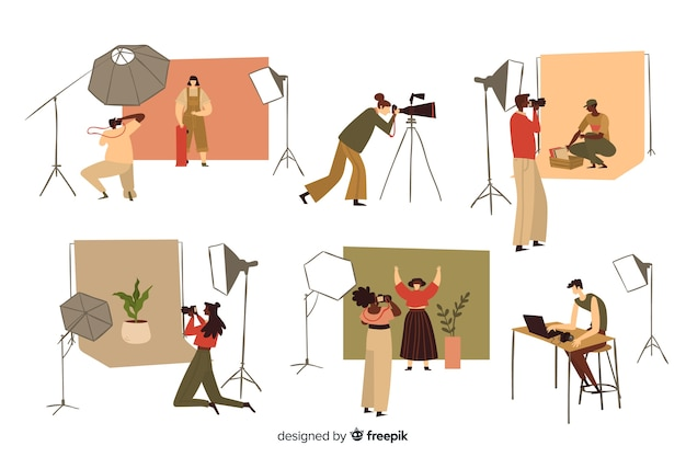 Photographers working in their studio Free Vector