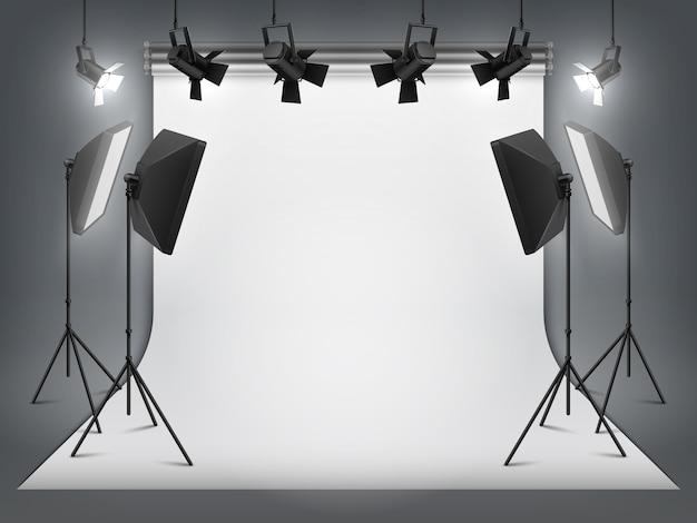 Photography studio. photo backdrop and spotlight, realistic floodlight with tripod and studio equipment Premium Vector
