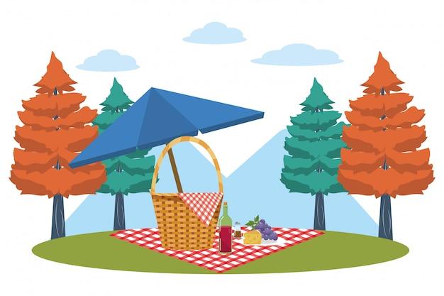 Picnic basket in forest Premium Vector
