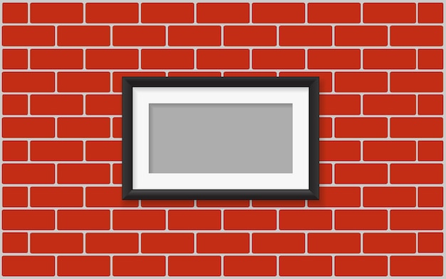 Picture frame on brick wall Premium Vector