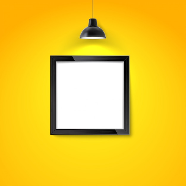 Picture frame on yellow wall with hanging lamp. blank photo frame or poster template. Premium Vector