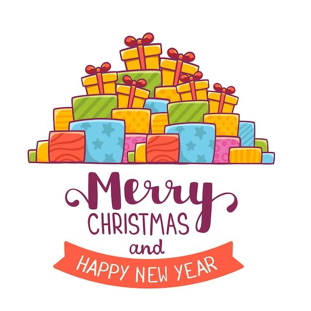 クリスマスプレゼントとテキストメリークリスマスの山 Premiumベクター