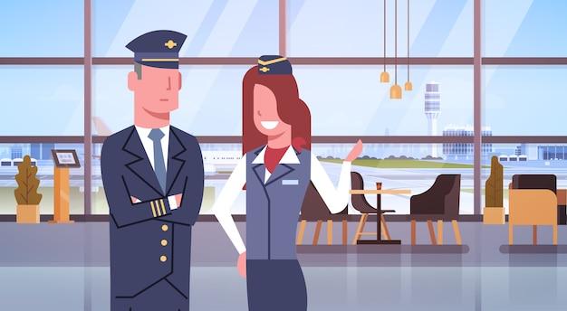 Pilot and stewardess in airport Premium Vector
