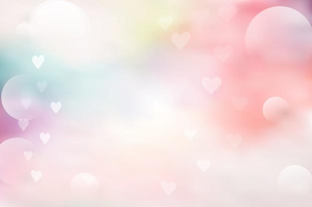 Розовый и синий абстрактный фон с боке на день святого валентина Premium векторы