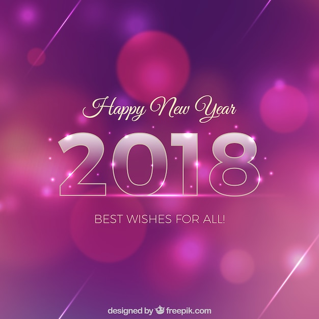 pink and purple new year background with bokeh effect free vector