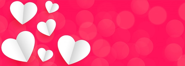 Pink background banner with white paper hearts for valentine day Free Vector