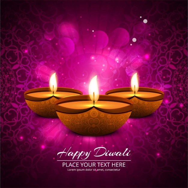 Pink background with three candles to celebrate\ diwali
