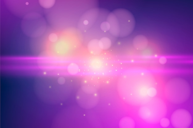 Pink bokeh effect background Free Vector