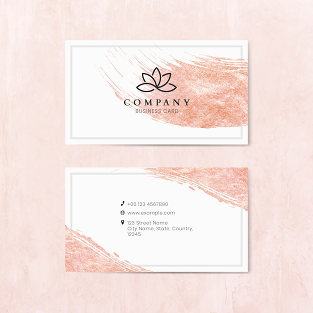 Pink brush stroke on a business card template Premium Vector