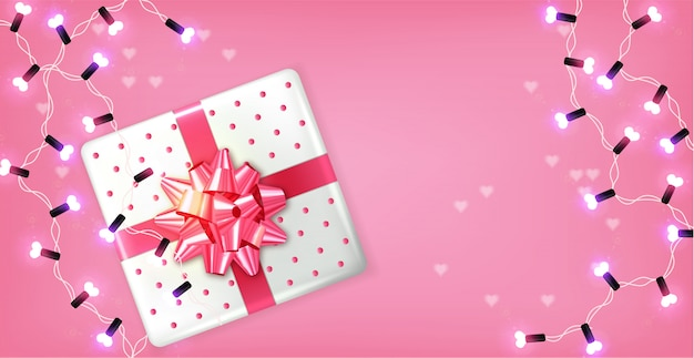 Pink gift box and lights garland Premium Vector