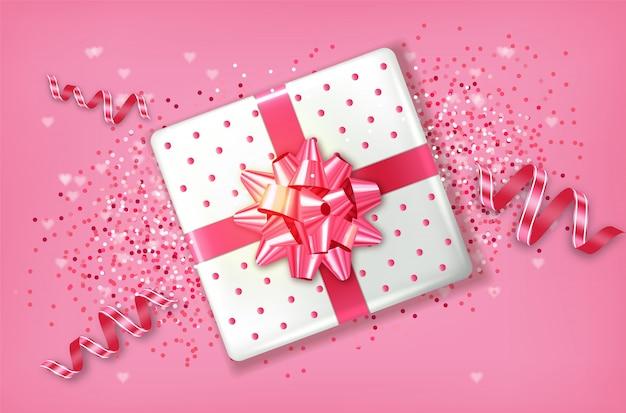 Pink gift box Premium Vector