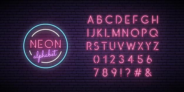 Pink neon alphabet. Premium Vector