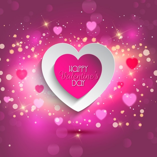 Pink valentine heart glowing background Vector | Free Download