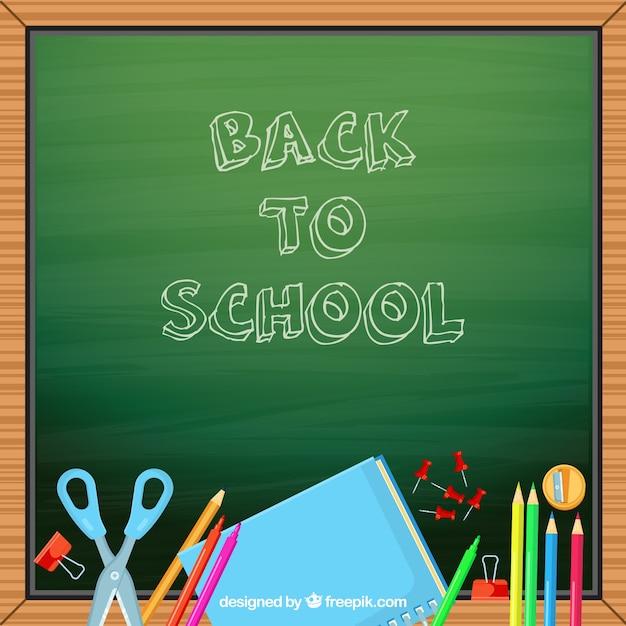 Pizzarra background with school supplies
