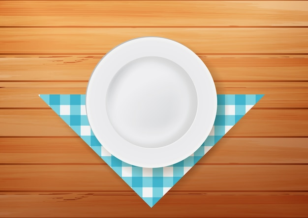 Plate with napkin on wood background Premium Vector