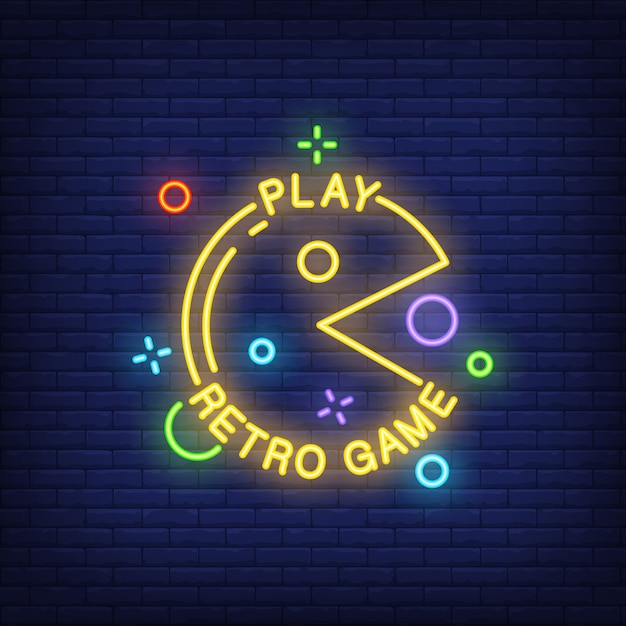 play retro game lettering with pacman sign on brick background neon