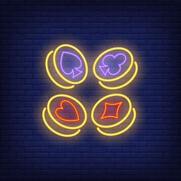 Playing card suit symbols on gold coins neon sign Free Vector