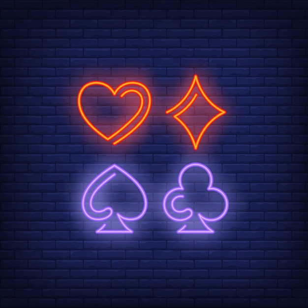 Playing card suit symbols neon sign Free Vector