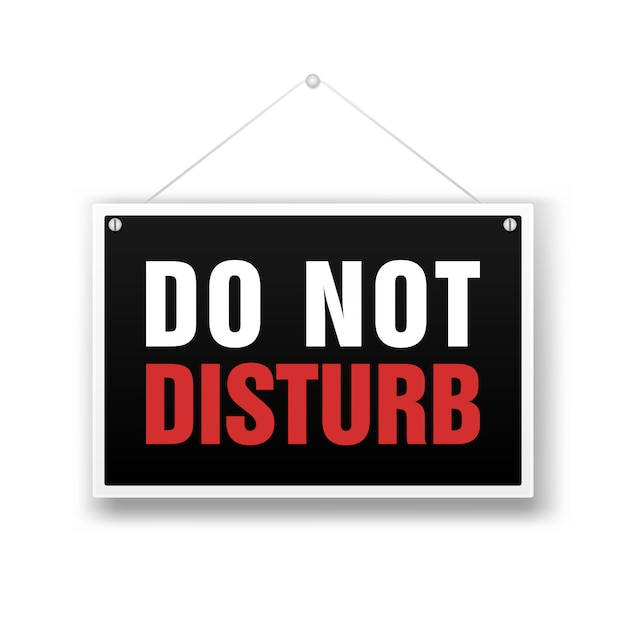 Please do not disturb, sign hanging on white Premium Vector