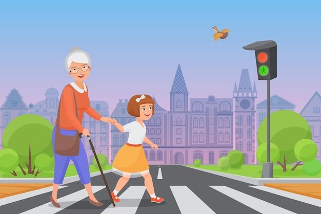 Вежливая девочка помогает улыбающейся старушке перейти дорогу по пешеходному переходу, пока светит зеленый свет. Premium векторы