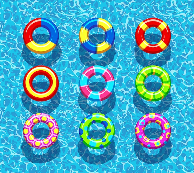 Pool rings on blue water Premium Vector