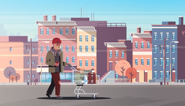 Poor man pushing trolley cart with belongings beggar guy walking street begging for help homeless modern city buildings cityscape Premium Vector