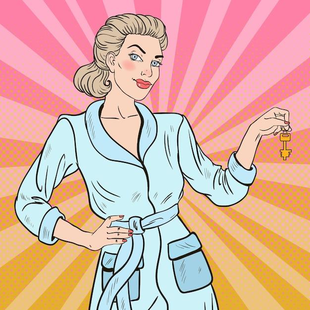 ポップアートキーを持つ美しいブロンドの女性 Premiumベクター