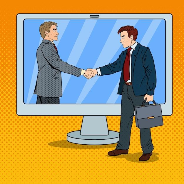 ポップアートのビジネスマンは、コンピューター画面を握手します。ビジネス契約。 Premiumベクター