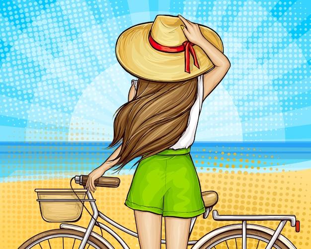 自転車でビーチでポップアートの女の子 無料ベクター