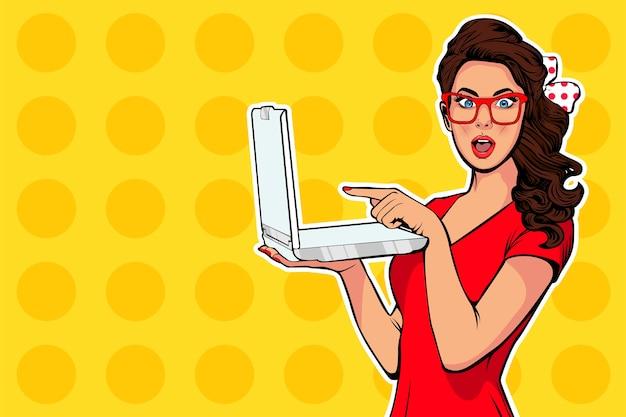 Pop art girl with laptop in the handpointing Premium Vector