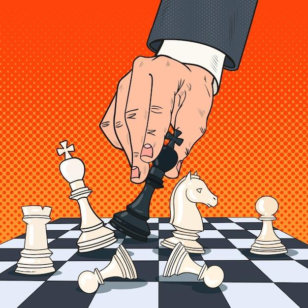Pop art hand of businessman holding chess figure. business strategy concept. Premium Vector