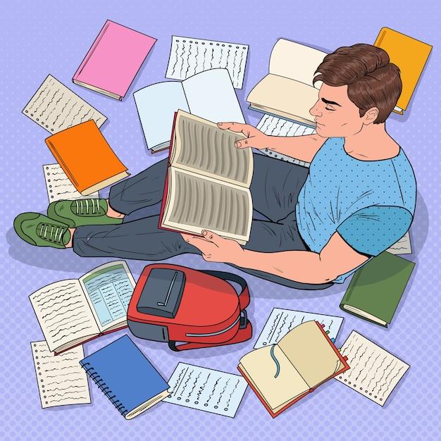 팝 아트 남성 학생 독서 책 바닥에 앉아. 시험을 준비하는 십대. 교육, 연구 및 문학 개념. 프리미엄 벡터