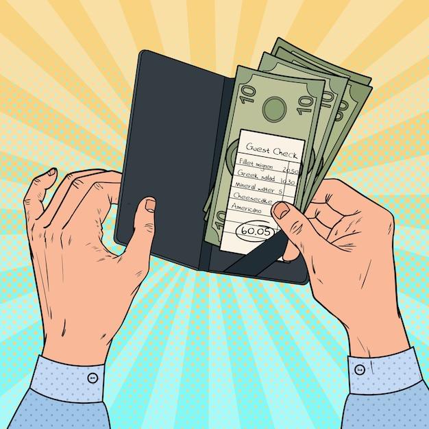 レストランで請求書を支払うポップアートの男。現金でのゲストチェック。 Premiumベクター