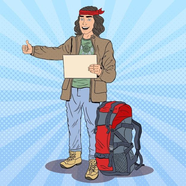Поп-арт улыбается автостопом с рюкзаком. Premium векторы