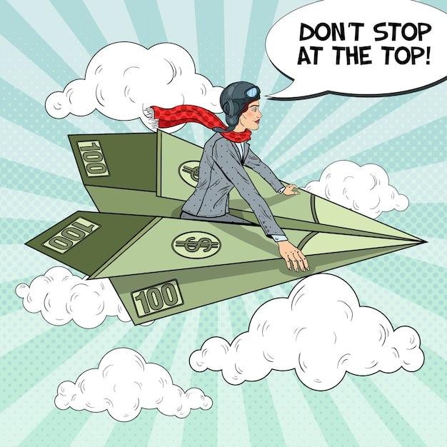 Поп-арт успешная деловая женщина, летящая на долларовом бумажном самолетике. Premium векторы